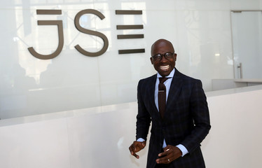South Africa's Finance Minister Malusi Gigaba poses for a photograph after speaking at the Thomson Reuters economist of the year awards