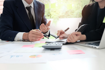 Financial planning Business man and Business woman talking to planner financial business, report finance in paper on office accounting desk.