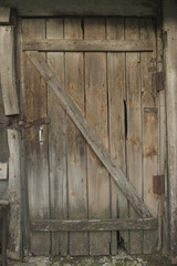 Old wooden door with rusty loops