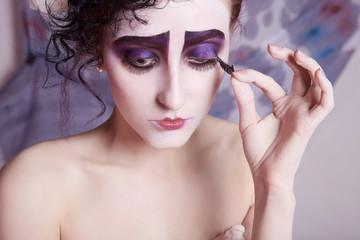 girl removes false eyelashes