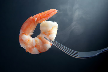 Acrylic Prints Seafoods Hot prawn on a fork