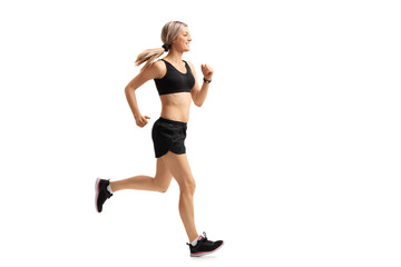 Full length profile shot of a woman running