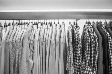 Men's shirts on the rack, black and white frame