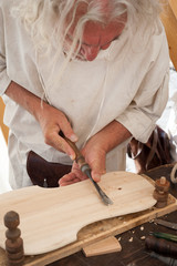 The luthier builds a medieval stringed instrument