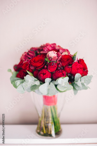 Wedding Bouquet Of Red Flowers And David Austin Roses Is In A Vase