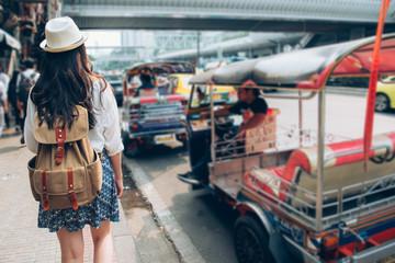 Thai traditional taxi tuk tuk car with woman.