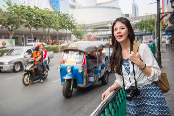 Woman tourist standing in busy bangkok street