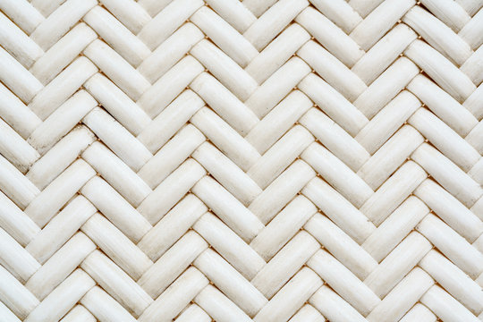 Close up synthetic white rattan weaving the seat of a chair