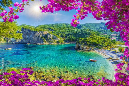 Wall mural Amazing bay with crystal clear water in Paleokastritsa, Corfu island, Greece