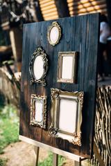 frames for gests list on wooden background