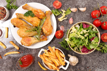 grilled chicken leg with french fries