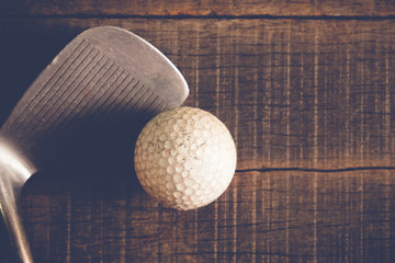 Antique golf club and ball with filter effect retro vintage style