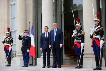 French President Emmanuel Macron greets U.S. President Donald Trump at the Elysee Palace in Paris