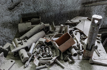 Old hardware covered with a thick layer of dust in an abandoned factory