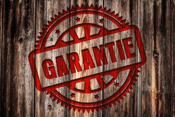 GARANTIE, Stempel auf Holz