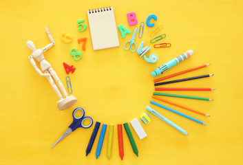 Back to school concept on yellow wooden background. Top view.