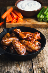 Roasted chicken wings with carrots, celery and dipping sauce