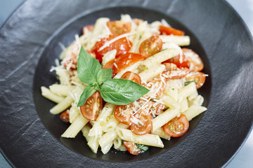 Penne pasta with cheese and cherry tomato