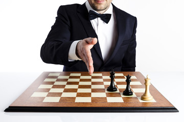 Game over. Smart man in a dark suit playing blacks has just won a game of 
