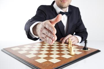 Handshake. Win or lose startegy. Chess game