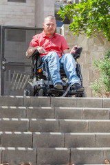Wheelchair man in front of staircase Barrier