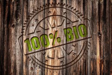 100% BIO, Stempel auf Holz