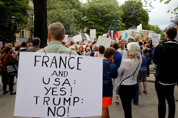 People gather to protest the visit of U.S. President Donald Trump in Paris