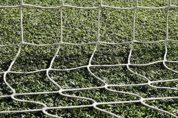 Close-Up Of Net On Grassy Field