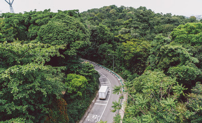 High Angle View Of Truck On Road Amidst Trees
