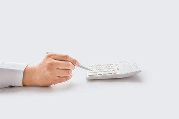 Hand press white calculator,isolated on gray background with clipping path.