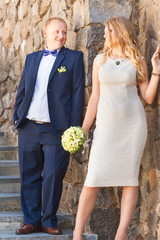 Happy newlyweds near bride and groom