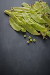 Fresh snow peas on slate background