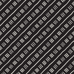 Hand drawn style ethnic seamless pattern. Abstract geometric tiling background in black and white. Vector freehand doodle texture.