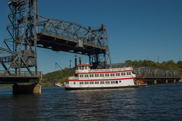 riverboat under lift bridge