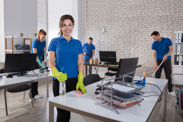 Happy Female Janitor In Office