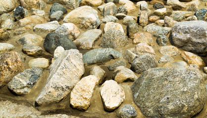 rocks and boulders in a dry creek bed