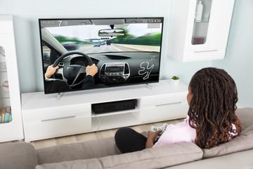 Girl Playing Video Racing Car Game