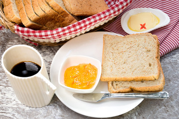 Toasted bread with fruit jam and coffee cup