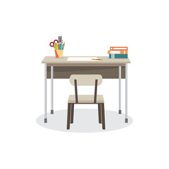 School desk with a chair. On the table are the school supplies.