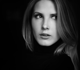 Black and white portrait of beautiful young woman. Selective soft focus.