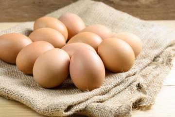 Pile of raw eggs on hemp sack