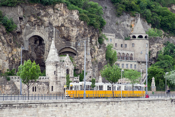 Yellow tram and Gellert hill caves in Budapest, Hungary