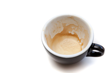 Stain of coffee in black cup on white background isolated Wall mural