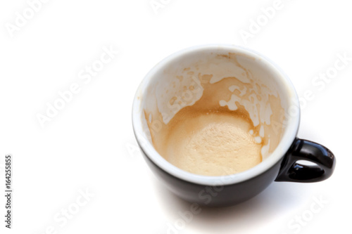 Wall mural Stain of coffee in black cup on white background isolated