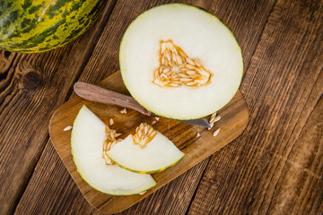 Wooden table with Futuro Melons (selective focus)