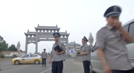 A still image from video shows security guards in exterior of Shenyang Xiheyuan funeral parlor, where China's Nobel Peace Prize-winning dissident Liu Xiaobo's remains were taken to, as a source close to the family said, in Shenyang, Liaoning province