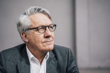 Portrait of senior businessman looking sideways
