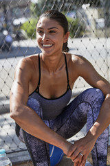 Smiling fit woman outdoors