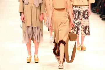 Models walk runway during fashion show