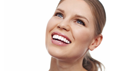 Teeth whitening. Dental care. Close-up of smiling female showing her perfect healthy teeth over white background with copy space.